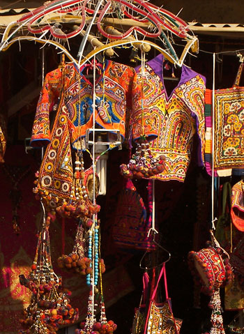 folk dress India in a local haat or market display